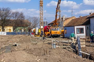 Workers are working on concreting at construction site.