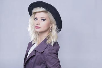 Fashion shot of a blonde woman wearing a hat