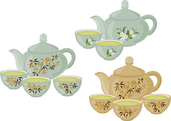 The teapot and small cups of Chinese green tea. Set of isolated objects.