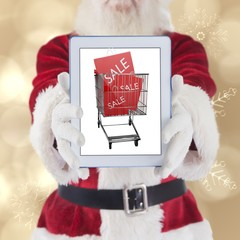 Composite image of santa presents a tablet pc