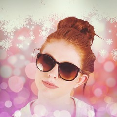 Composite image of hipster redhead wearing large sunglasses