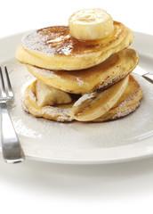 fluffy ricotta pancakes with banana isolated on white background