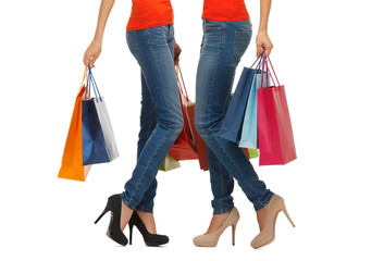 close up of women with shopping bags