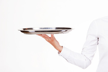 Woman arm in witer uniform holding tray. Over white background.