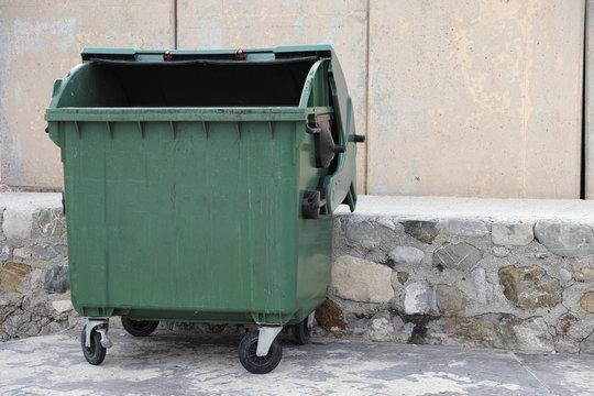 Empty trash dumpster