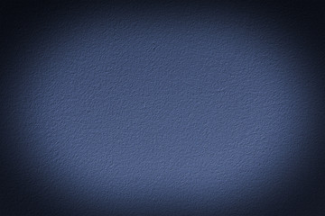 Navy blue wall with vignette, a background or texture