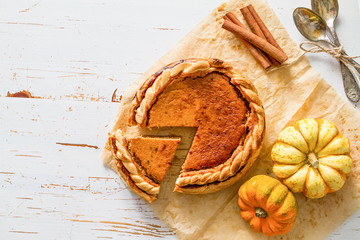 Pumpkin pie, white wood background