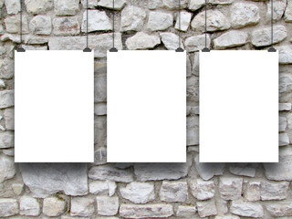 Three frames on medieval stone wall background
