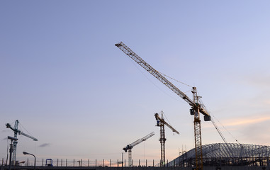Cranes in the construction of large buildings.