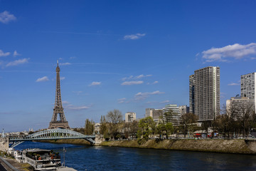 River Seine Embankment with Eiffel Tower (La Tour Eiffel). Paris