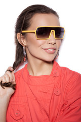 Young smiling woman in sunglasses on white background