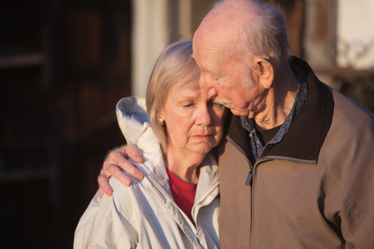Man Comforting Sad Woman