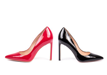 red and black female high heel shoes isolated