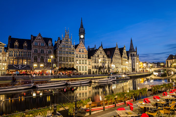 "Picturesque medieval buildings overlooking the ""Graslei harbor"" on Leie river in Ghent town, Belgium, Europe. Nightscene."