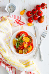 Colorful tomato salad basil