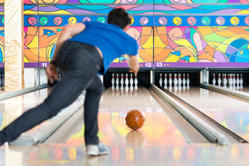 Young man bowling having fun
