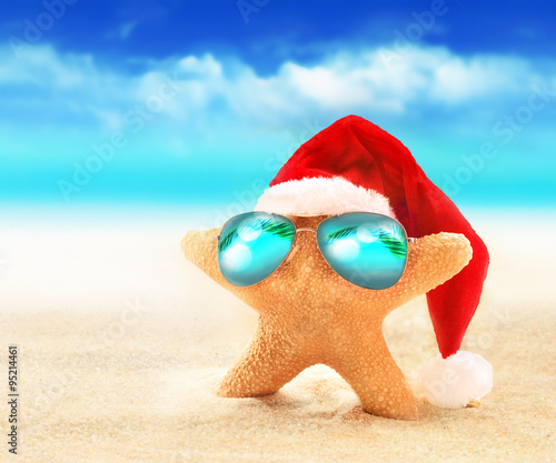 starfish in sunglasses on summer beach and santa hat merry christmas - Merry Christmas Beach Images