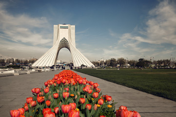Azadi Monument of Tehran Behind Red Tulips Edited with Brown Vintage Filter