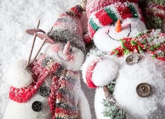 Cute snowmen on snowy field