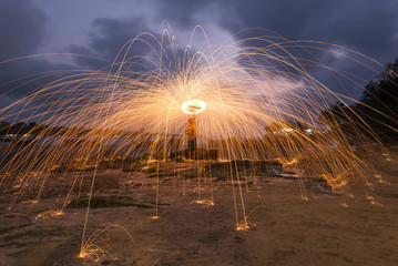 Men cast Beach Fire steel wool .