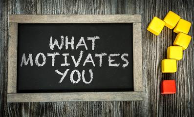 What Motivates You? written on chalkboard