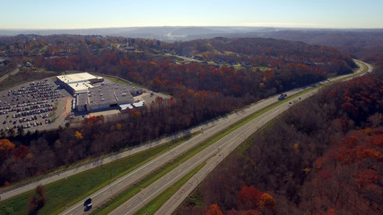 An aerial shot over a western Pennsylvania interstate in late Autumn.