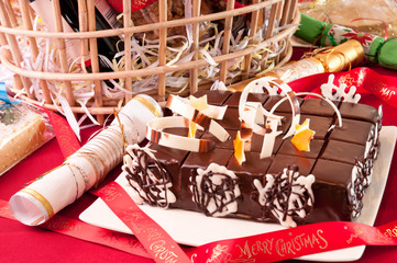 Christmas chocolate cake with gift hamper background