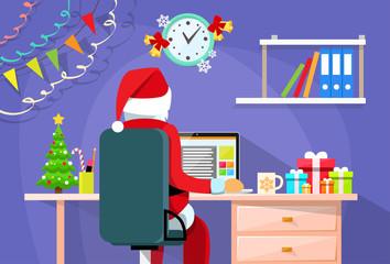 Santa Claus Sitting Desk Using Laptop Internet Back Rear View Christmas Holiday