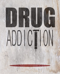 drug addiction sign with needle on wood grain texture