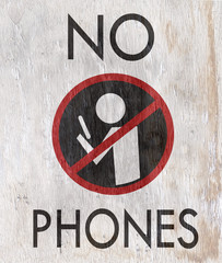 no phones sign on wood grain texture