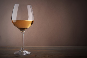 Poster Alcohol Glass of white wine on wooden table
