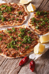 Turkish lahmacun closeup on a wooden table. vertical