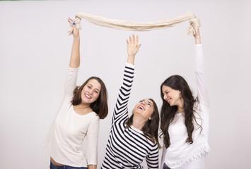 short girl trying to reach taller girls scarf