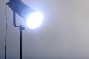 Closeup video light shines standing on black tripod