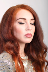 Portrait beautiful young girl with red hair with closed eyes