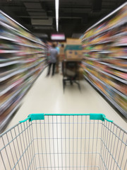View of a shopping cart and aisle at supermarket