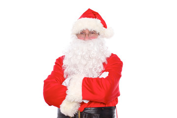 Kind Santa Claus standing with crossed arms, isolated on white background