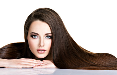 Portrait of beautiful young woman with long straight brown hair