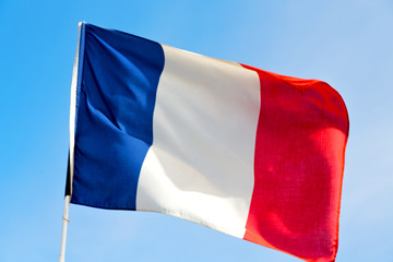 flag in the blue sky  france  colour and wave
