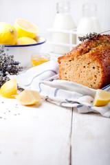 Lavender, lemon cake with fresh lemons and lavender flowers