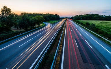 Photo sur Plexiglas Autoroute nuit Sunset long-exposure over a german highway