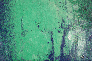 Hoarse,scratched and peeled surface with green and blue paint