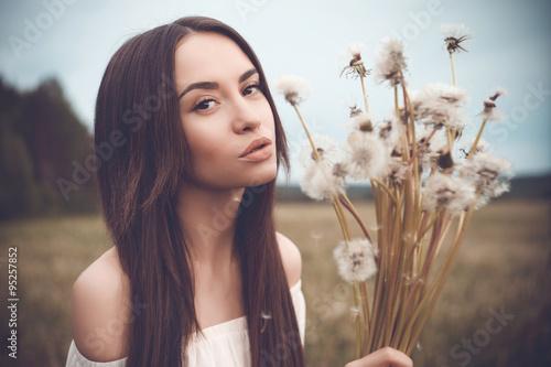 Beautiful woman in field