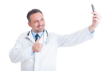 Confident and successful doctor or medic taking a selfie