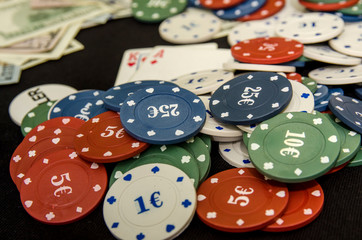 combination of poker playing cards, chips and dollar