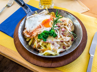 Famous Swiss Rosti with ham, cheese, eggs, onion and rozmarin.