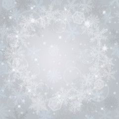 Abstract light christmas background with snowflakes.