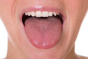 Woman Showing Tongue Over White Background