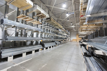 construction material warehouse, shelves with aluminum profiles