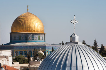 The silver dome of Our Lady of the Spasm Armenian Catholic Church and the golden Dome of the Rock rise over the Old City of Jerusalem. Wall mural